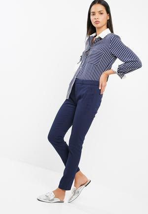 blue and white striped shirt with dark blue jogger chinos