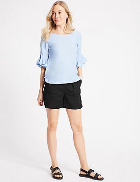 blue chiffon blouse with bell sleeves, black cargo shorts