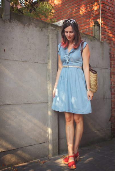 blue dress with belt and flared knee-length dress with red heels