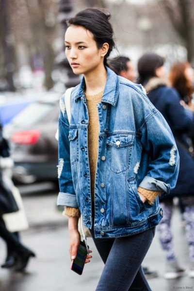 blue boyfriend denim jacket with green knitted sweater with round neckline