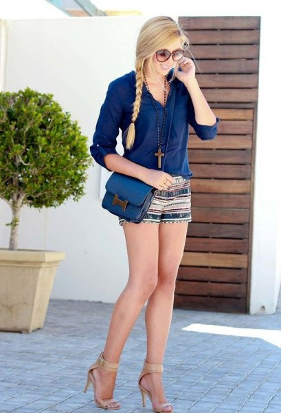 blue blouse with buttons and mini-shorts with tribal print