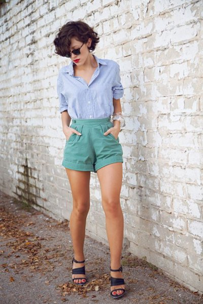 blue shirt with buttons and gray vintage shorts