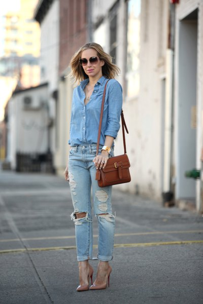 blue shirt with buttons and ripped boyfriend jeans