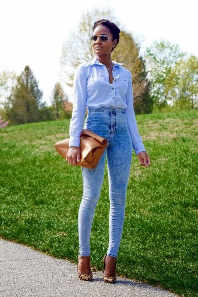 blue shirt with buttons and specially washed vintage jeans