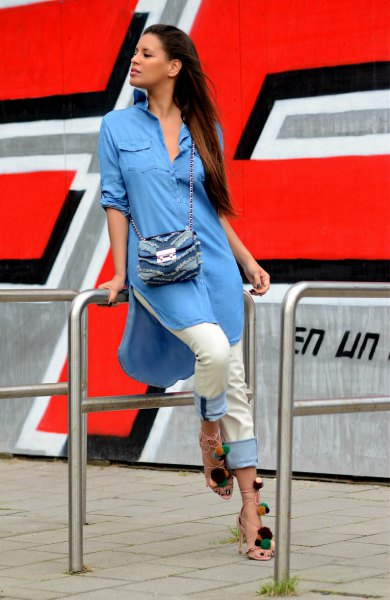 blue chambray shirt dress with button fastening, white trousers and denim shoulder bag