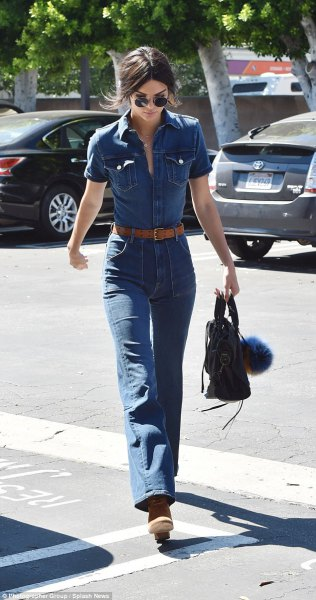 blue chambray shirt with buttons and high-waisted jeans with a bell bottom