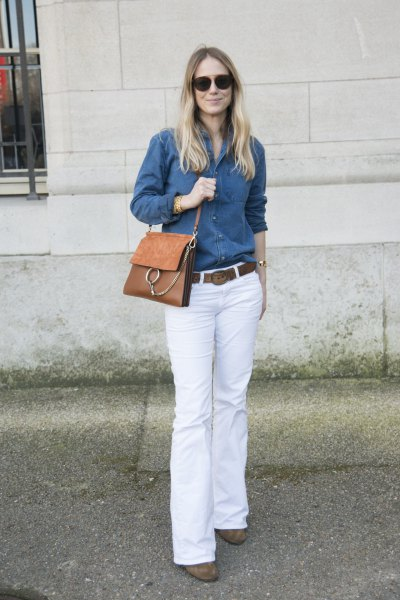 blue chambray shirt with buttons and white jeans with a bell bottom