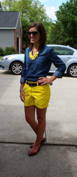 blue chambray shirt with buttons and yellow shorts