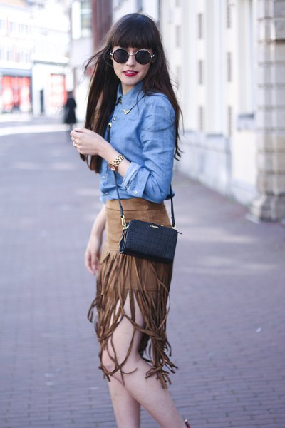 blue chambray shirt with green suede fringed skirt