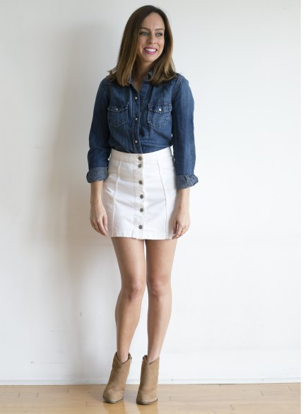 blue chambray shirt with white jeans button on the front of the skirt