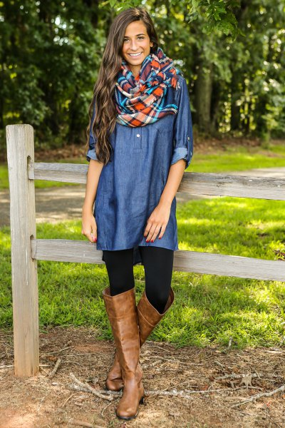 blue coated chambray shirt with brown leather boots above the knee