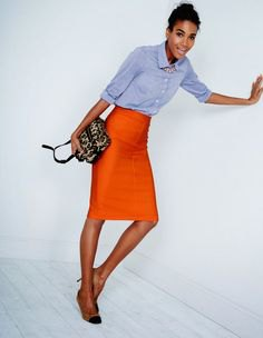 blue chambray shirt with button placket and orange midi skirt