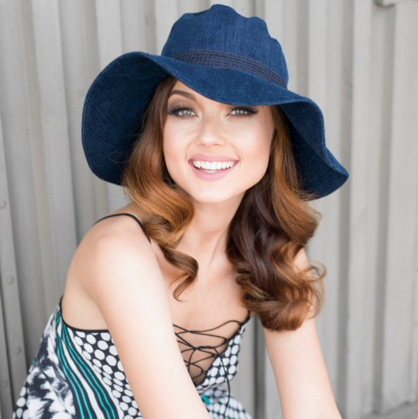 Blue denim floppy hat with a gray polka dot lace-up dress