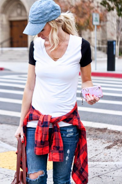 blue denim hat with ripped blue jeans and red plaid shirt