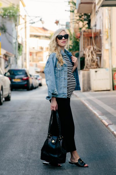 blue denim jacket with black and white striped top and black trousers with wide legs