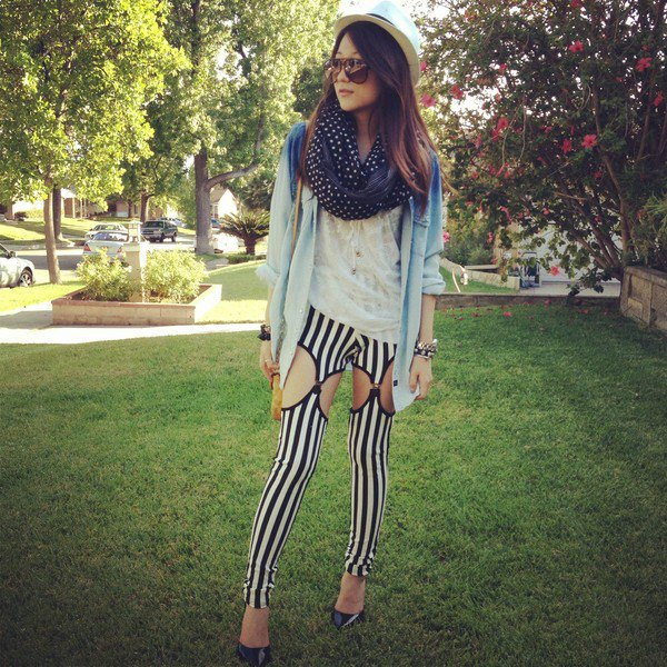 blue denim jacket with black and white vertical striped leggings