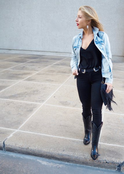 blue denim jacket with black cowboy belt