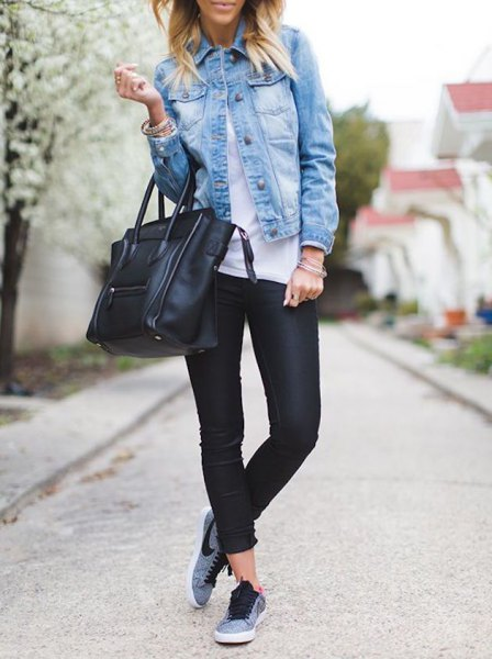 blue denim jacket with black leather pants and gray hiking tennis shoes