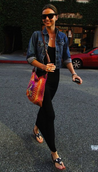 blue denim jacket with black maxi dress made of jersey with scoop neckline