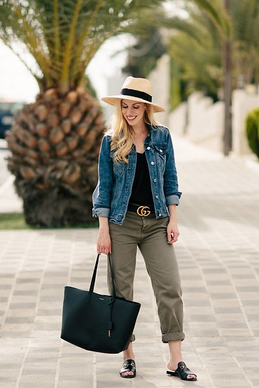 blue denim jacket with black tank top and straw hat