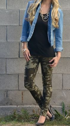 blue denim jacket with black tunic tank top and leggings