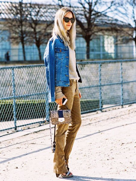 blue denim jacket with a blushing pink sweater and brown corduroy jeans