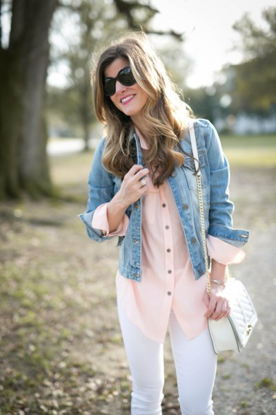 blue denim jacket with a blushing silk blouse and white jeans