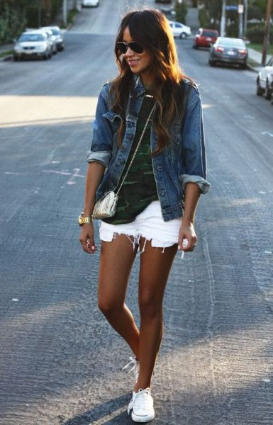 blue denim jacket with camouflage shirt and ripped white denim shorts