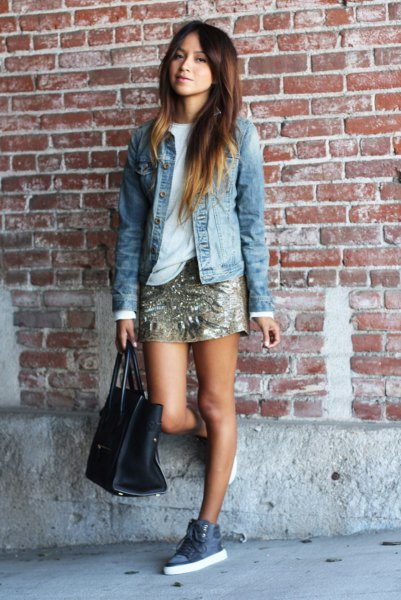 blue denim jacket with gold mini skirt and high canvas shoes