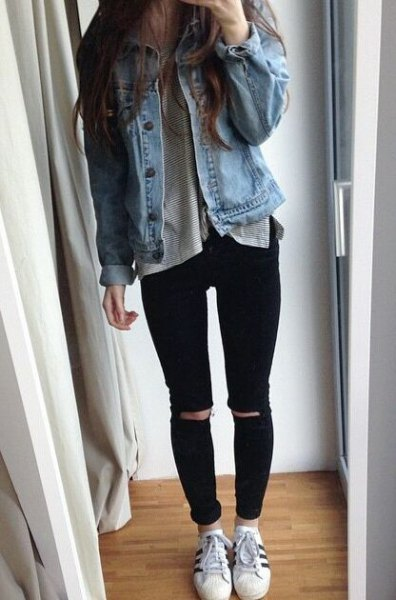 blue denim jacket with gray t-shirt and ripped jeans