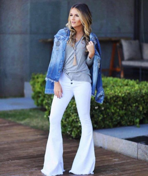 blue denim jacket with gray t-shirt and white jeans with bell bottom