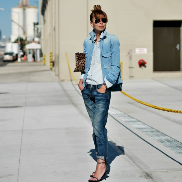Blue denim jacket with a light chambray shirt with buttons and straight leg jeans with cuffs