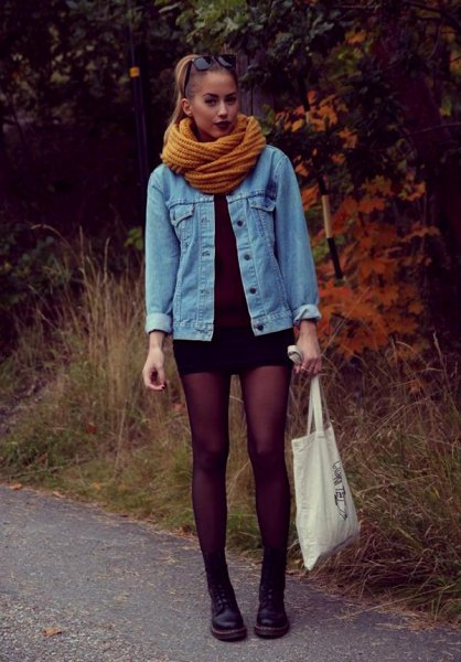 blue denim jacket with light green scarf and black mini dress