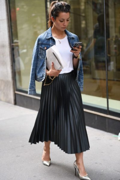 blue denim jacket with black pleated skirt in maxi