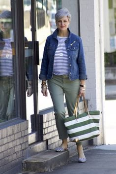 blue denim jacket with striped t-shirt and gray pants