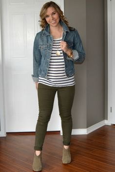blue denim jacket with striped T-shirt and olive-green drainpipe trousers