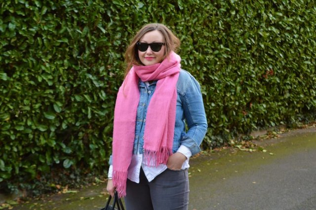 blue denim jacket with white shirt and shocking pink scarf