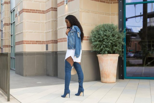 blue denim jacket with white mini dress and high-heeled denim boots