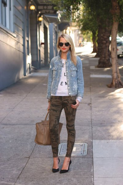 blue denim jacket with white print sweater and camouflage gaiters