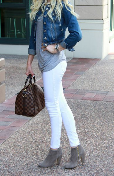 blue denim jacket with white skinny jeans and gray ankle boots