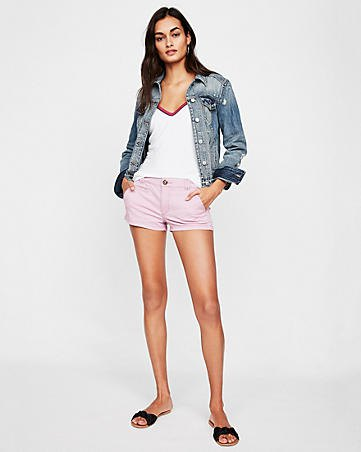 blue denim jacket with white tank top with V-neck and light gray shorts
