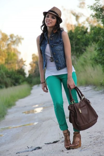 blue denim mini vest with white tank top and gray slim fit trousers with cuffs