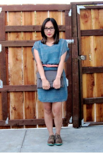Mini dress with blue denim scoop neckline and wingtip shoes made of brown leather