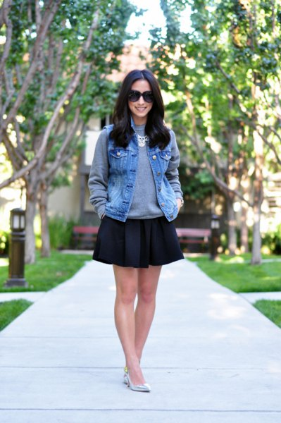 blue denim vest with gray sweatshirt with round neck and black skater skirt