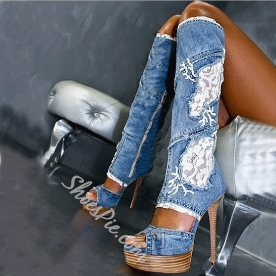 blue embroidered, knee-high jeans boots with an open toe cutout
