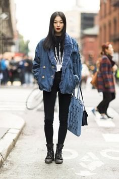 Boyfriend denim jacket with a blue faux fur collar and black high-rise jeans
