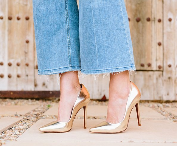 blue flared short jeans with black and gold heels