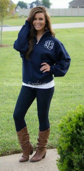 blue hoodie with half zip, black leggings and boots