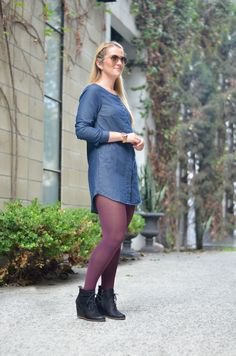 blue leggings and black leather ankle boots
