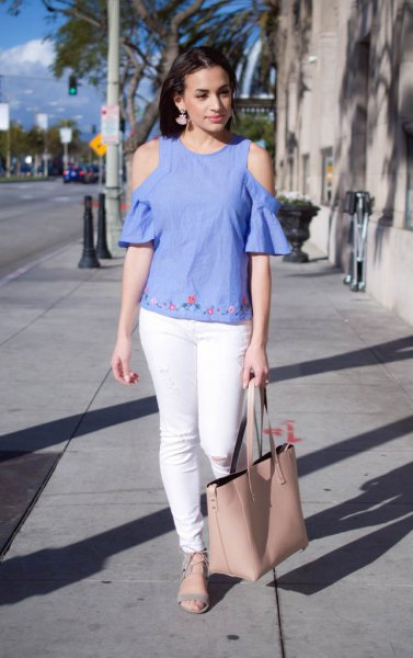 Cold shoulder blouse made of blue linen with subtle embroidery